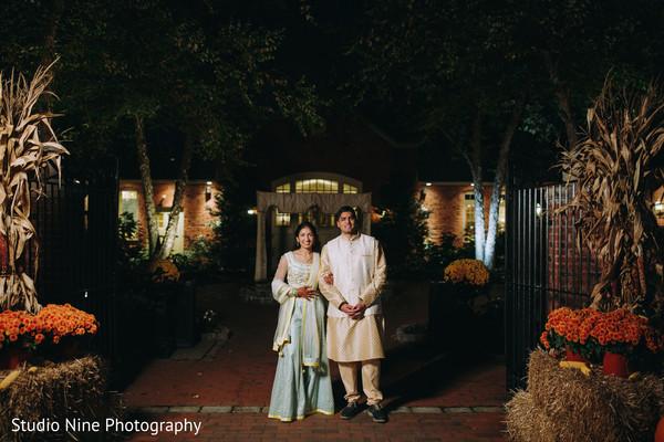 Indian couple posing at night