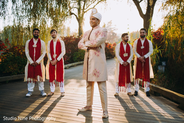 Indian groom posing in front of his Indian groomsmen