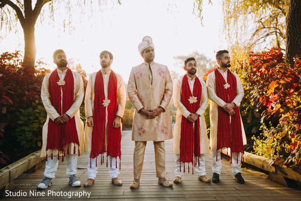 Indian groom and Indian groomsmen posing at sunrise