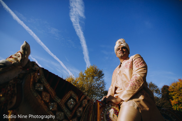 Another picture of the Indian groom riding a white mare