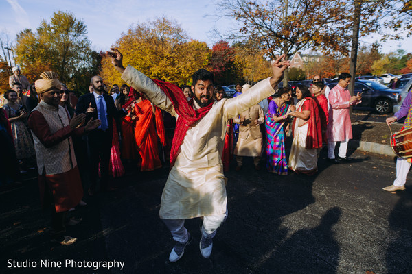 One of the Indian groomsmen dancing during the Baraat