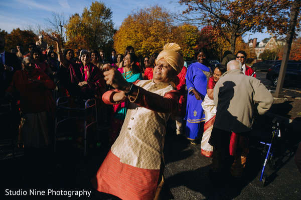 Indian relatives dancing during the Baraat