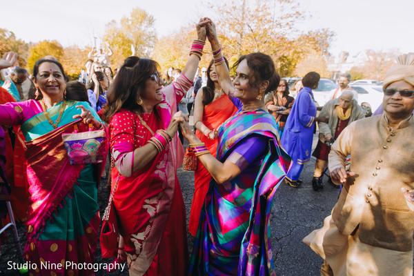 Indian relatives dancing during the Baraat
