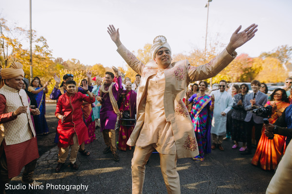 Indian groom dancing during the Baraat
