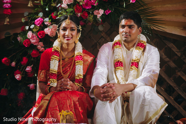 Indian couple sitting during the ceremony