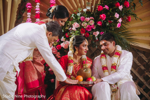 Indian couple being given a platter with fruits