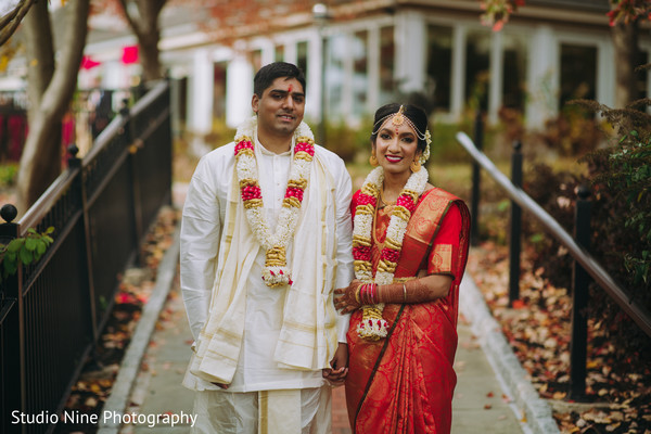 Indian couple posing on their wedding attire