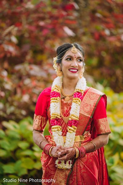 Maharani posing in her wedding lengha