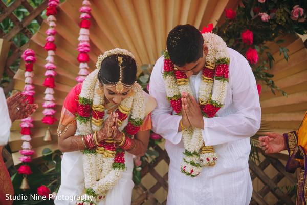 Indian couple saying a prayer