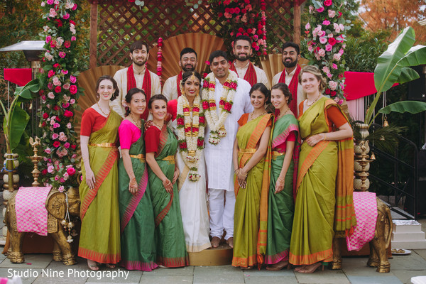 Indian newlyweds with the Indian groomsmen and the Indian bridesmaids