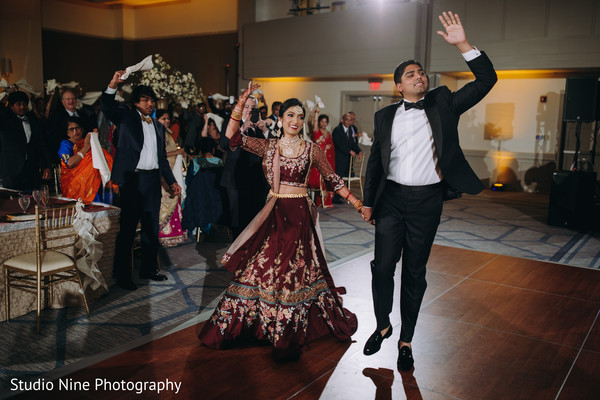 Indian newlyweds arriving at the reception hall