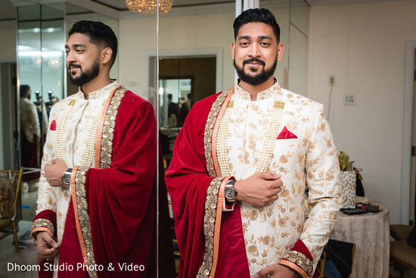 Indian groom posing on the waiting room