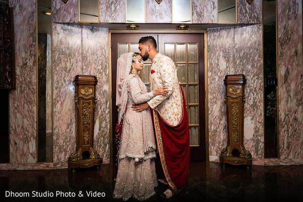 Indian groom kissing Maharani's forehead