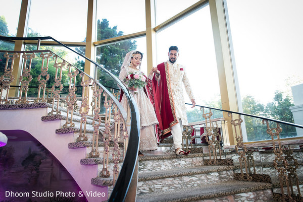 Indian newlyweds going down the stairs