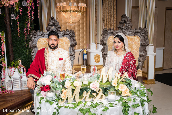 Indian newlyweds sitting at their dinner table