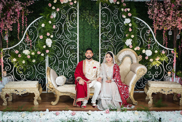 Indian newlyweds sitting together on a decorated stage