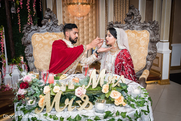 Indian groom sharing food with Maharani