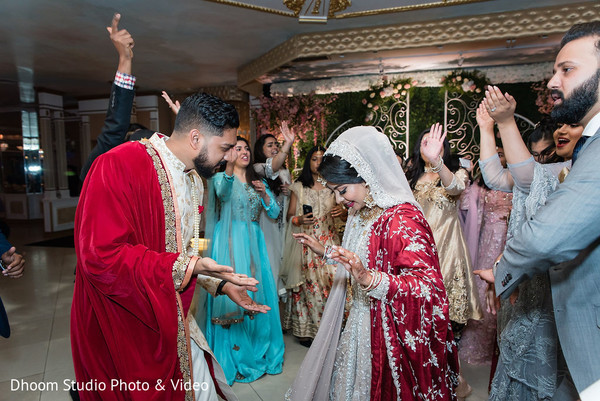 Indian newlyweds, Indian relatives and guest on the dance-floor