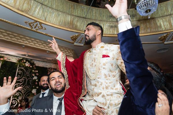 Indian groom being carried on shoulders