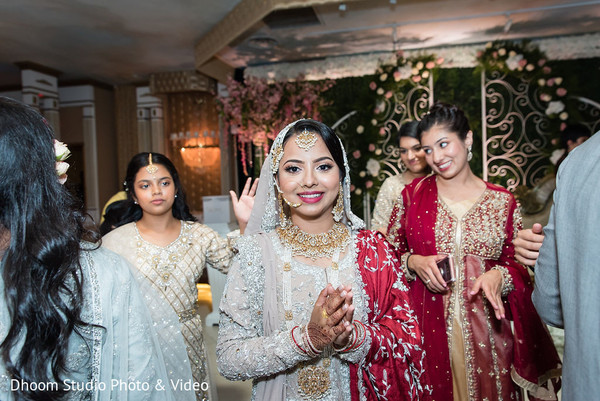 Indian bride followed by her Indian bridesmaids