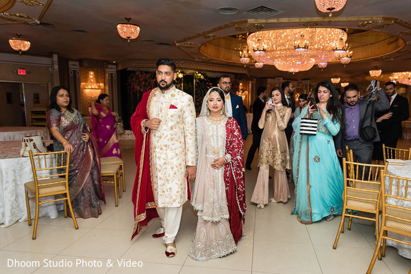 Indian newlyweds about to leave the reception hall