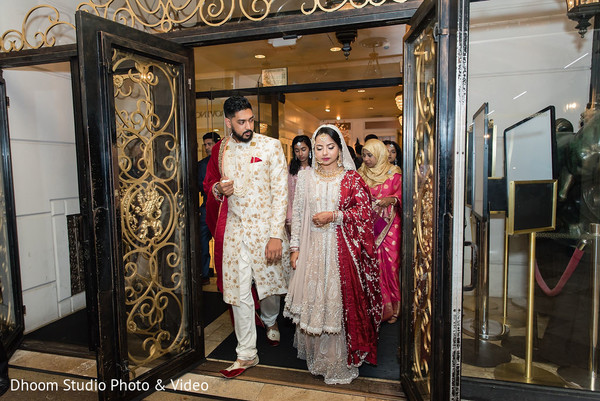 Indian newlyweds leaving the building