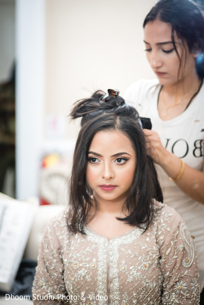 Indian bride getting her hair done