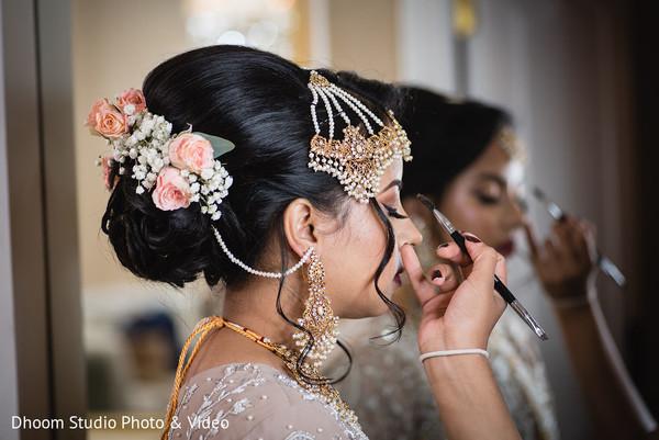 Make up artist working on Maharani's eyelids