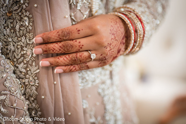 A take of Maharani's engagement ring on her henna stained hand