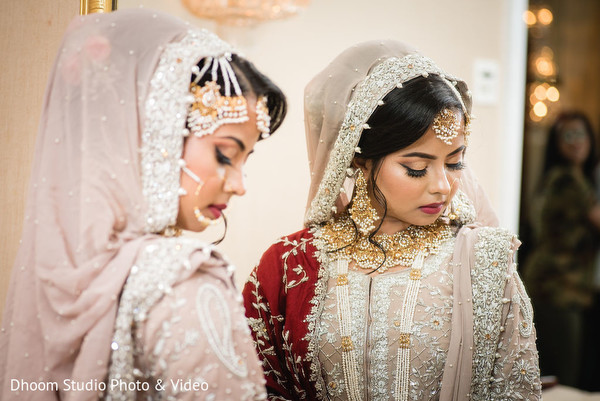 Indian bride posing in front of the mirror