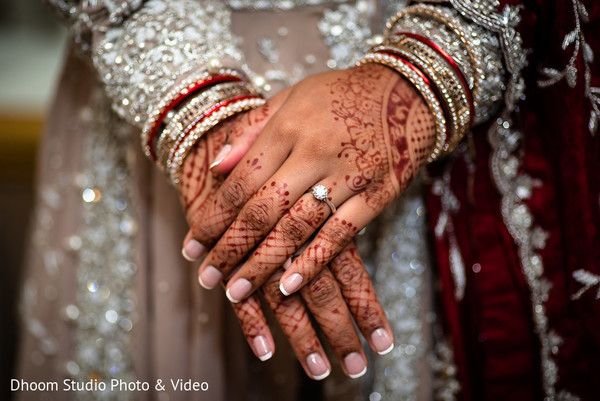 A close up to the Indian bride's henna stained hands