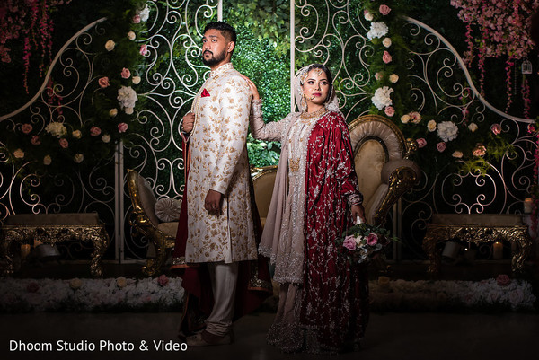 Indian couple posing on the decorated stage