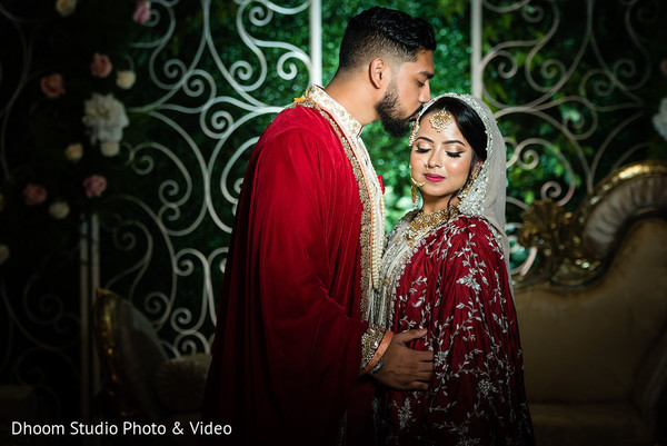 Indian groom kissing his Maharani's head