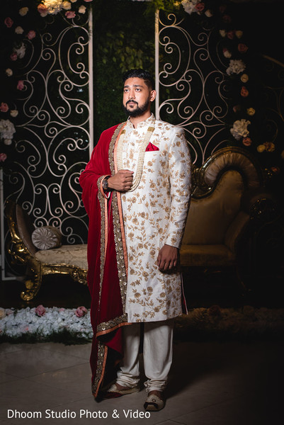 Indian groom posing on stage