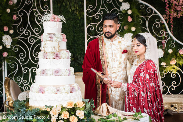 Indian couple cutting the cake