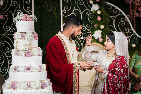 Indian bride sharing some cake with the Indian groom