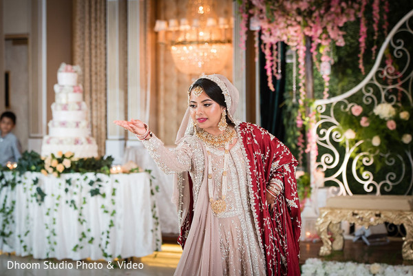 Indian bride dancing during the reception