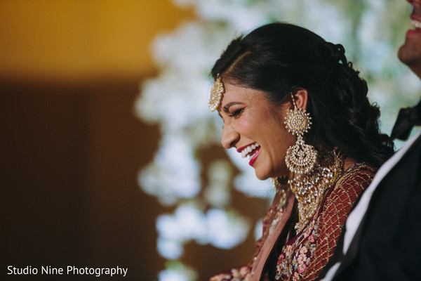 Indian newlyweds laughing together