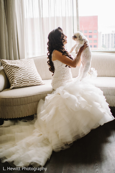 Maharani with her pet on her white wedding mermaid dress.