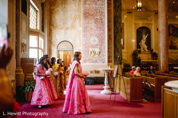 Indian bridesmaids making their entrance to wedding ceremony.