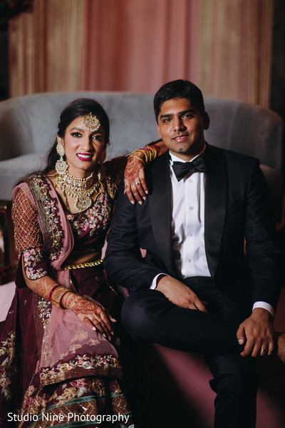 Indian newlyweds in their reception attires