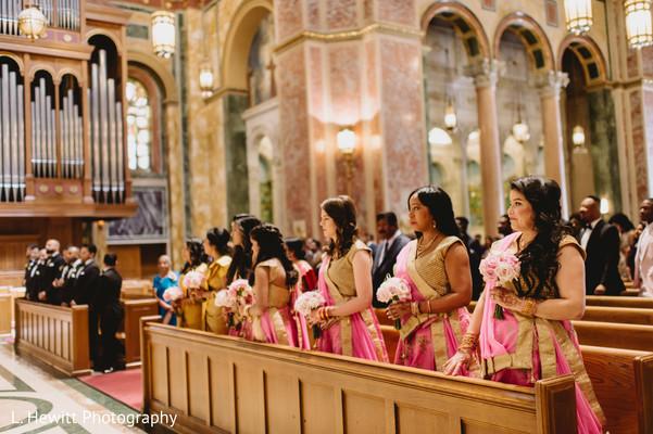 Indian bridesmaids at church on their pink saris.