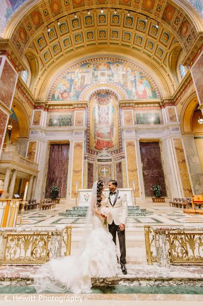 Indian couple posing inside Christian wedding church.