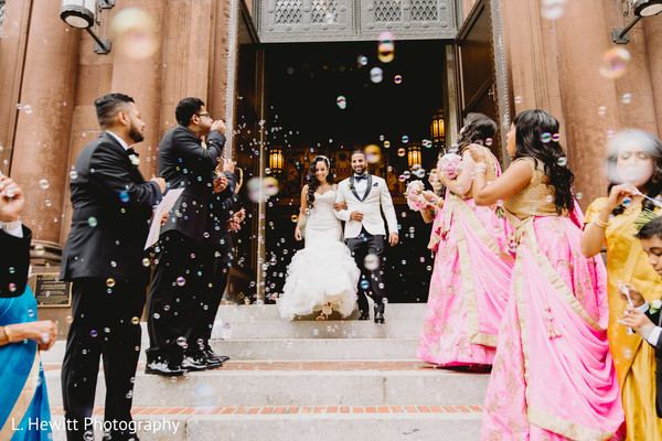 Indian couple walking out of Christian wedding ceremony.