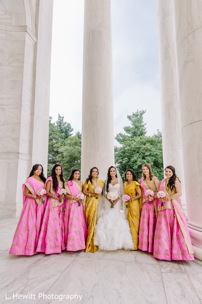 Indian bride with bridesmaids on their wedding ceremony outfits.