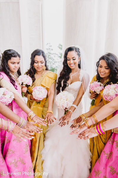 Maharani Indian bridesmaids showing their mehndi art.