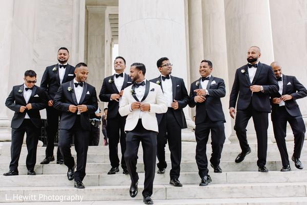 Indian groom with groomsmen on wedding ceremony suits.