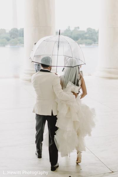 Maharani and raja walking with an umbrella capture.