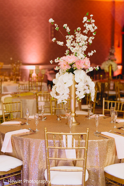 Indian wedding white and pink flowers table centerpiece.