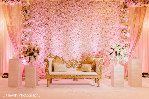 Indian wedding reception stage pink flowers decorations.